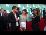 Kat Graham interviews Magic Mike star Channing Tatum and his wife, actress Jenna Dewan-Tatum on the red carpet at the 2012 MTV Movie Awards.